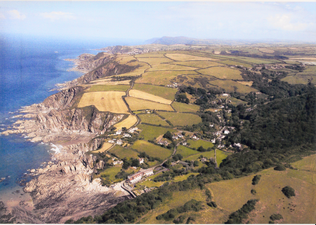 Summer aerial image looking East at low water. Ilfracombe just visible in the distance.